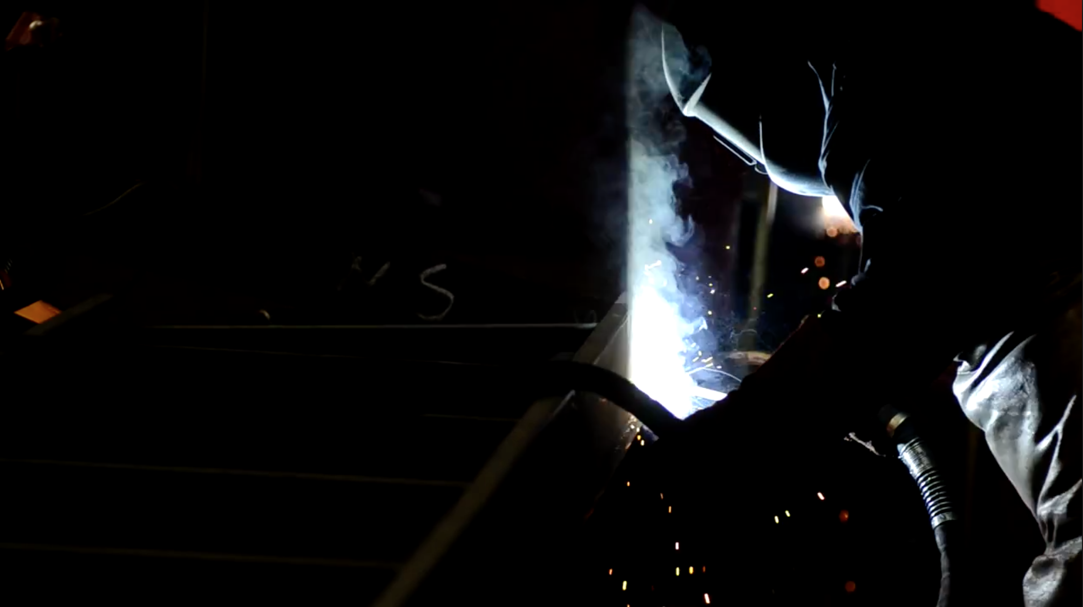 welder-at-work-inside-of-plant1